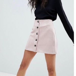 Blush suede mini skirt with buttons